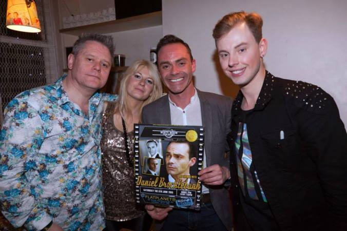Stuart Morriss, Jen Morriss, Daniel Brocklebank & Chris Collins with the poster designed for the event by Ronnie Clark