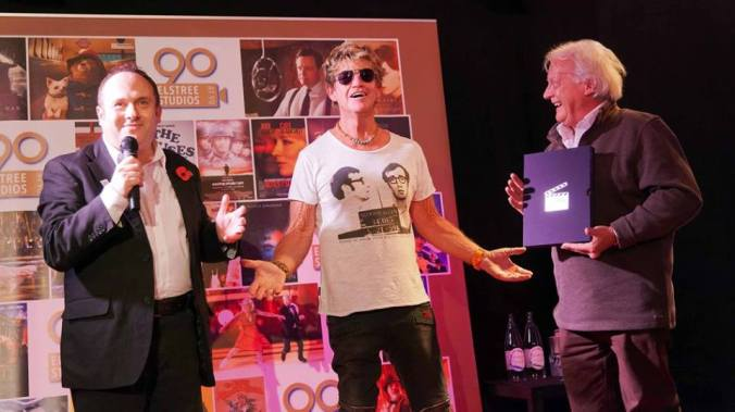 The Chairman and The Director of Elstree Studios give Robin Askwith an award