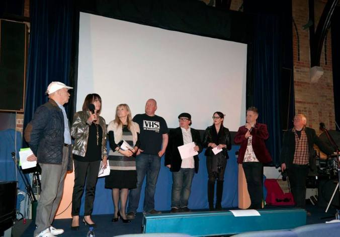The judges on stage, Brian Murphy, Judy Matheson, Linda Regan, Dominic Brunt, Perry Benson, Emma Dark and Stuart Morriss