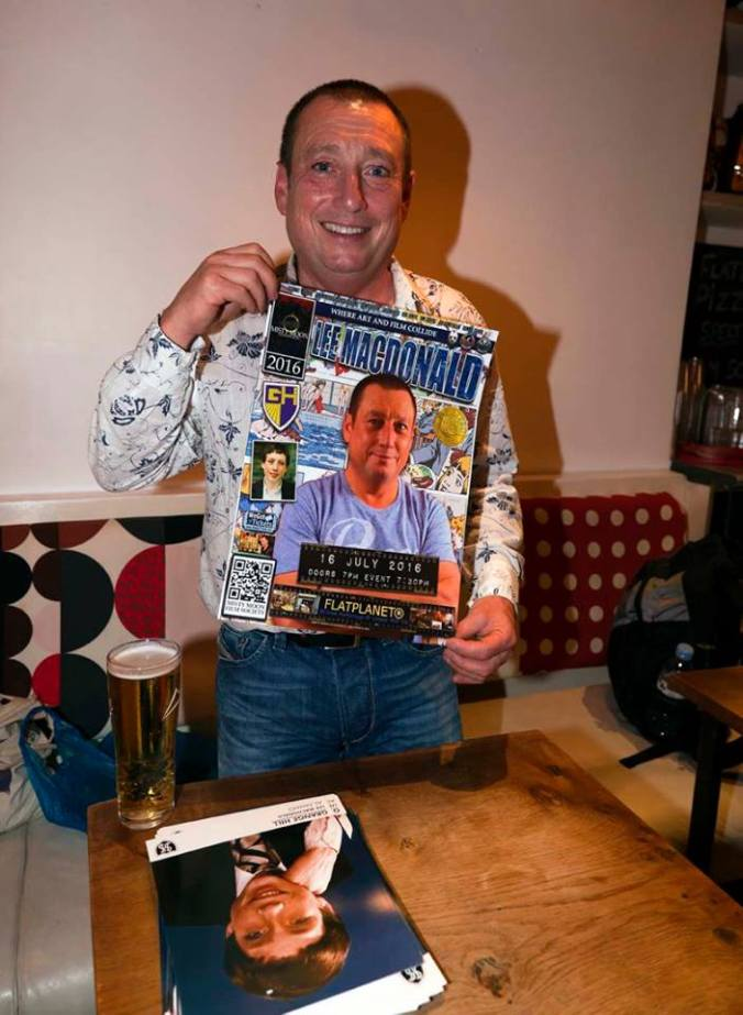 Lee Macdonald with the poster designed by Ronnie Clarke