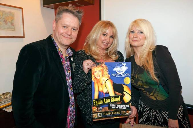 Stuart & Jen Morriss with Paula Ann Bland and a different poster designed by Ronnie Clark