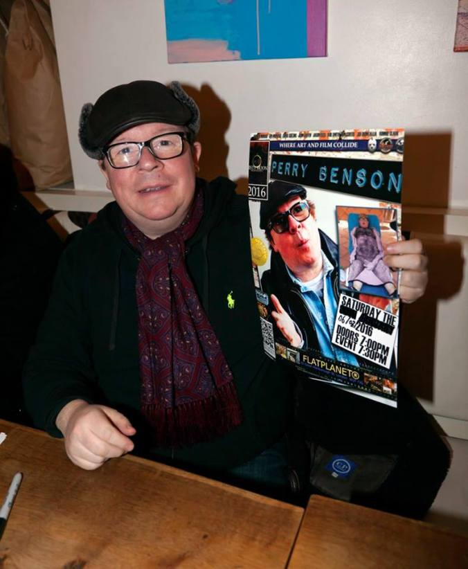 Perry Benson with the poster designed by Ronnie Clarke